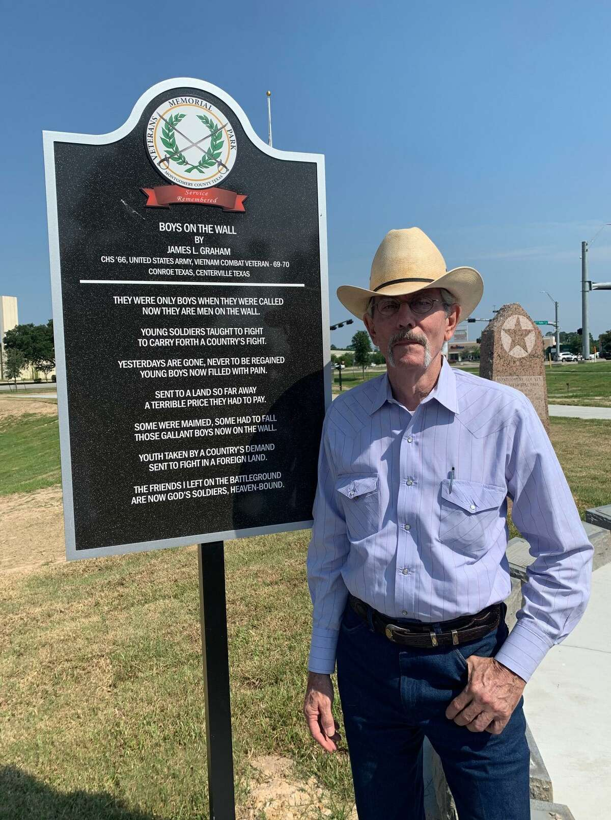 """On Monday, Mayor Jody Czajkoski and members of the Conroe City Council, the local Army unit and members of the Montgomery County Veteran's Memorial Commission celebrated the birthday of the U.S. Army at the newly dedicated Veteran's Memorial Park in Conroe. Pictured is James Graham who wrote the poem """"Boys on the Wall."""" Graham and Judge Jimmie Edwards III were classmates at Conroe high."""