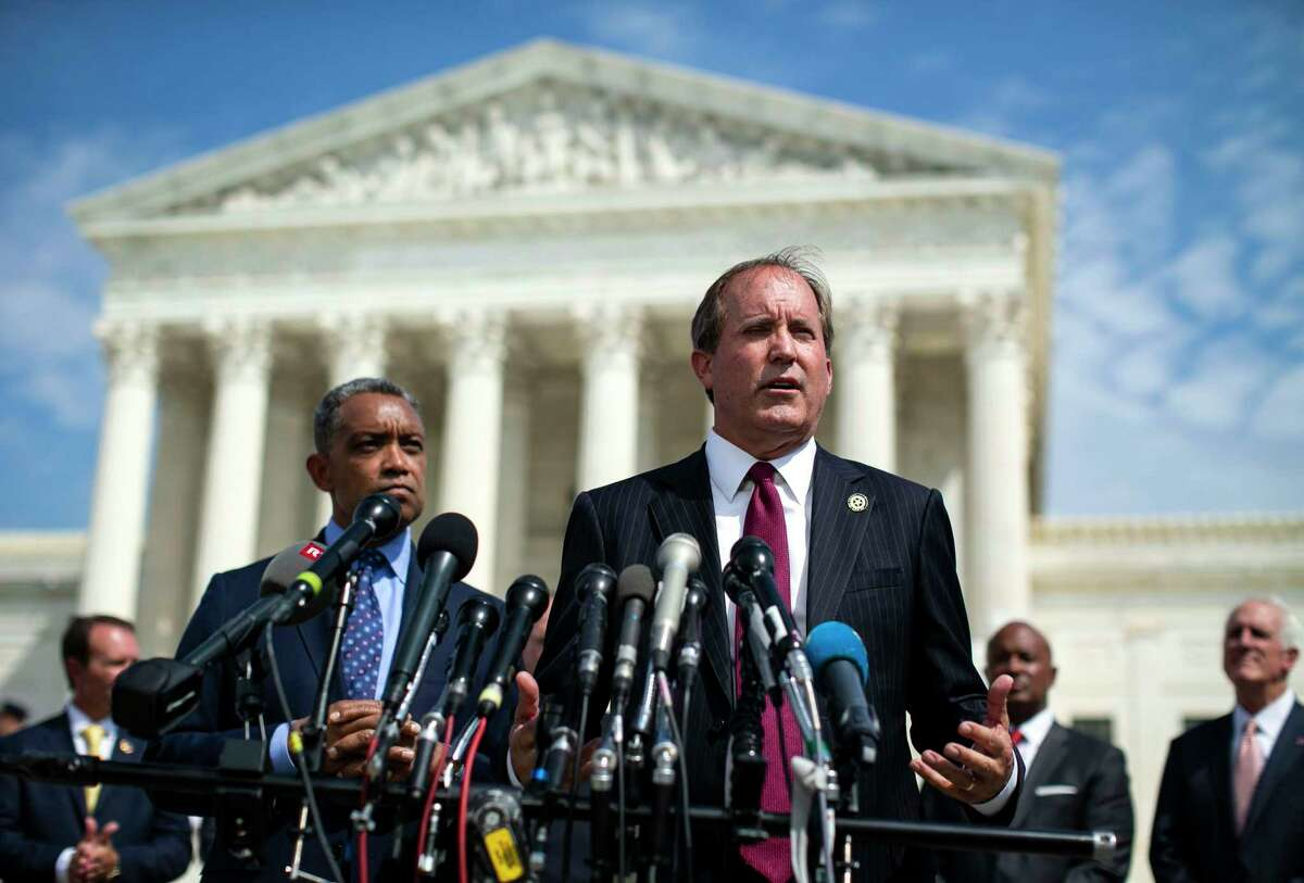 Texas Attorney General Ken Paxton speaks at a news conference outside the Supreme Court in Washington on Monday, Sept. 9, 2019, as District of Columbia Attorney General Karl Racine, left, and other state attorneys general look on. The state attorneys general from more than four dozen states officially declared on Monday that they are beginning investigations into the market power and corporate behavior of big tech companies. (Al Drago/The New York Times)