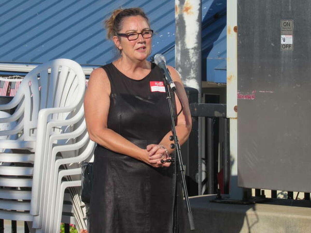 YWCA of Alton Executive Director Dorothy Hummel addresses the 2021 Women of Distinction honorees Wednesday evening at the Alton Marina, where the women's names were announced publicly for the first time since they were selected from numerous nominees submitted by community members. The YWCA hosted the marina mixer for the new Women of Distinction Academy members as well as past honorees, all of whom now are forever members of the academy, established by the YWCA of Alton over 30 years ago.