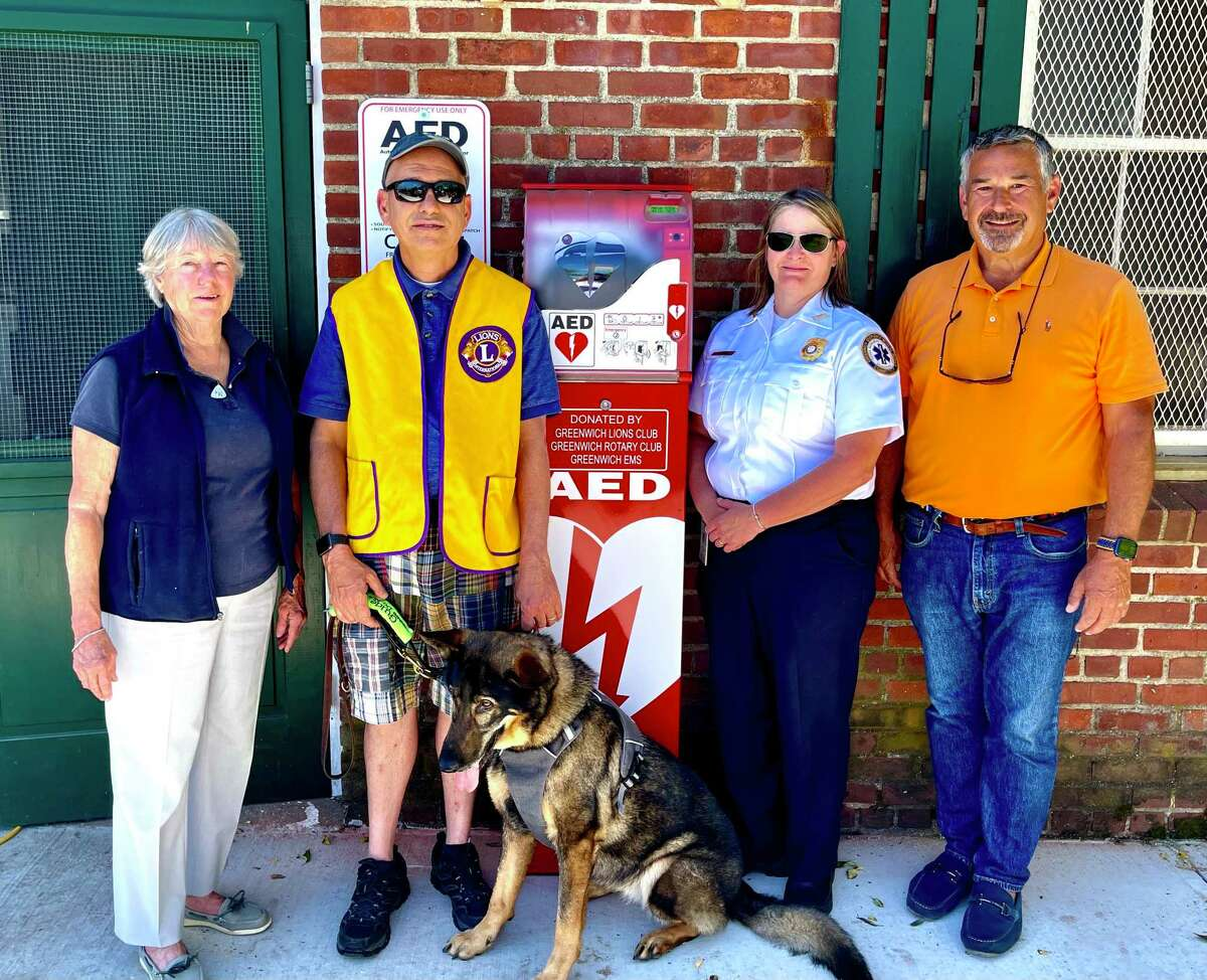 Sally Paris, Alan Gunzburg, Tracy Schietinger and Phil Brous - all members of either the Greenwich Emergency Medical Service, the Greenwich Rotary Club, the Greenwich Lions Club or the Friends of Greenwich Point - show off a recently installed AED at Greenwich Point. The automated external defibrillator was placed near the concession stands at the south end of Greenwich Point.
