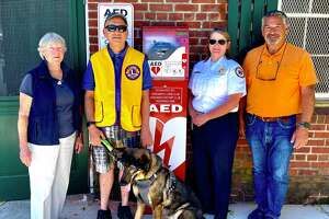 Sally Paris, Alan Gunzburg, Tracy Schietinger and Phil Brous — all members of either the Greenwich Emergency Medical Service, the Greenwich Rotary Club, the Greenwich Lions Club or the Friends of Greenwich Point — show off a recently installed AED at Greenwich Point. The automated external defibrillator was placed near the concession stands at the south end of Greenwich Point.