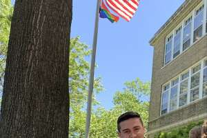 Jimmy Tickey, a top aide to Congressman Jim Himes and a LGBTQ elected official in the city, with his niece, Magnolia Mikula, at the Pride flag raising Wednesday, June 16, 2021, at Shelton City Hall.