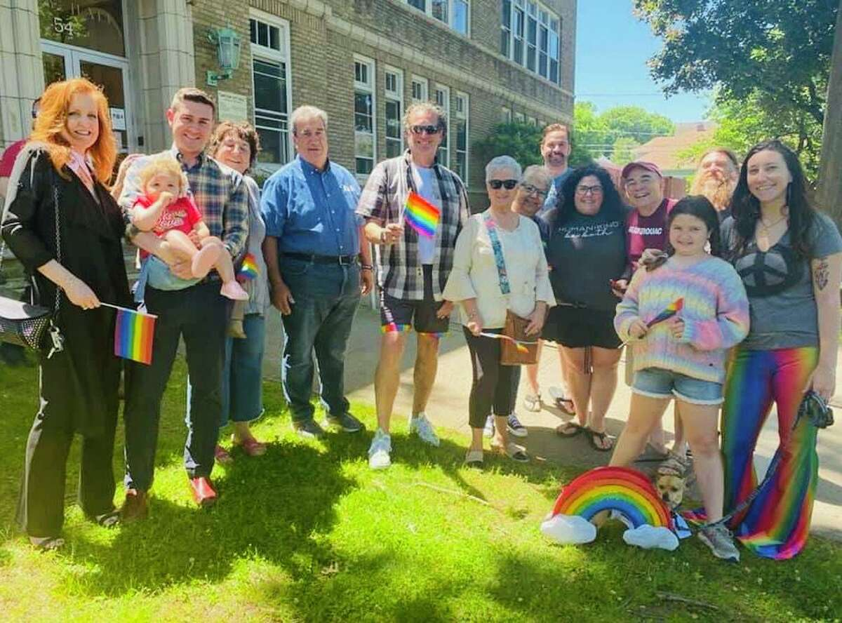 Crowds gathered outside Shelton City Hall Wednesday, June 16, 2021, for the raising of the Pride flag and the reading of a proclamation by Mayor Mark Lauretti recognizing National Pride Month.