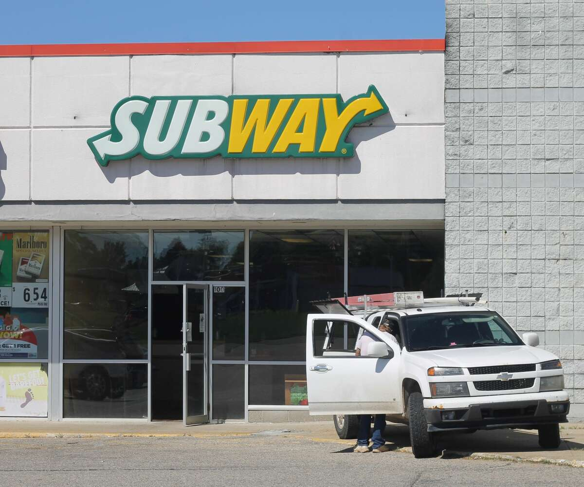 Work is done Tuesday to empty the Subway restaurant in Manistee. The sandwich shop closed Sunday night and will be reopening in a new location on June 28.