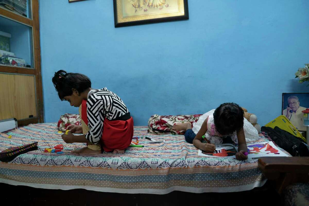 Five-year-old twins Ruhi and Mahi lost both of their parents to covid-19 during India's second wave in Bhopal, India. They now live with their great-uncle.
