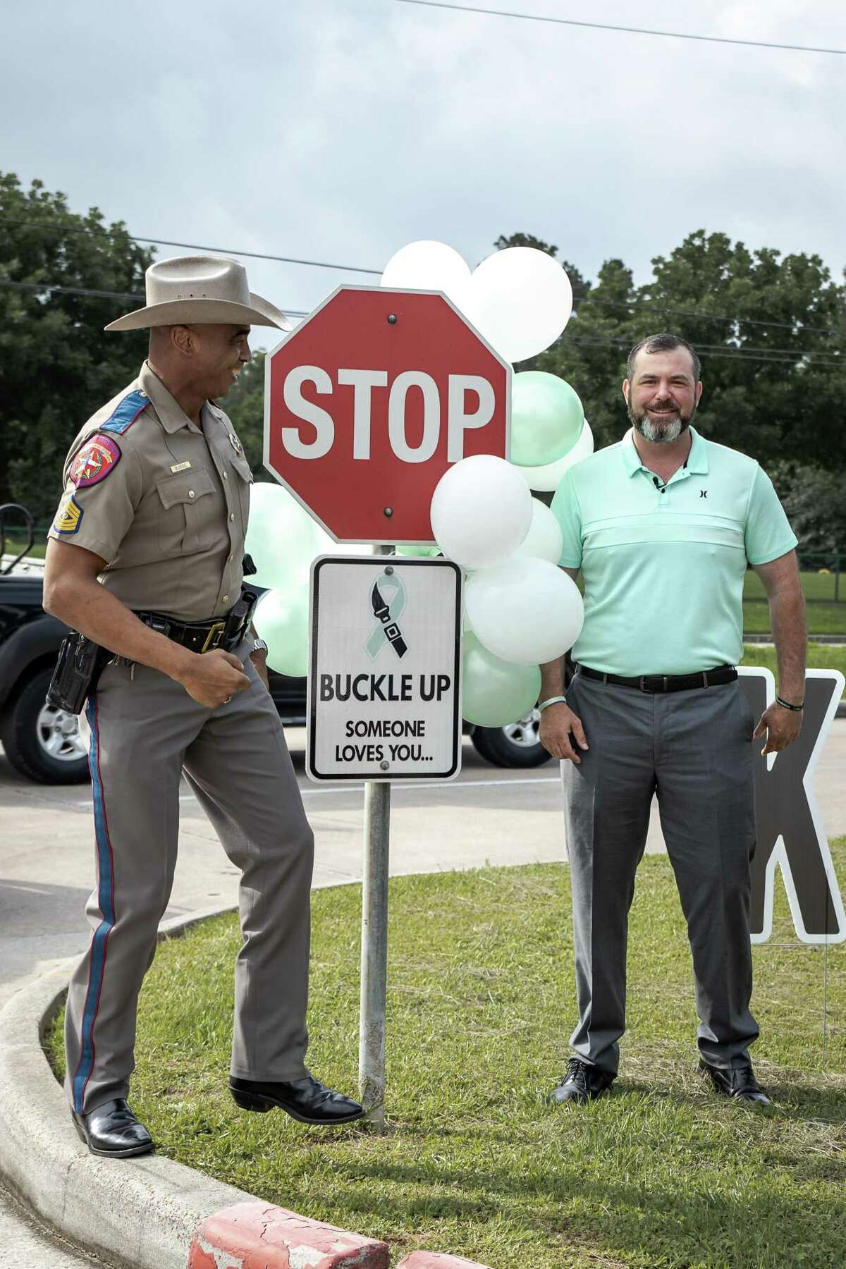 The Kailee Mills Foundation is joined by family, friends and first responders for the unveiling of a seat belt safety road sign at Klein Collins High School on May 27, 2021. Signs were installed at all Klein ISD middle school and high school parking lot exits.