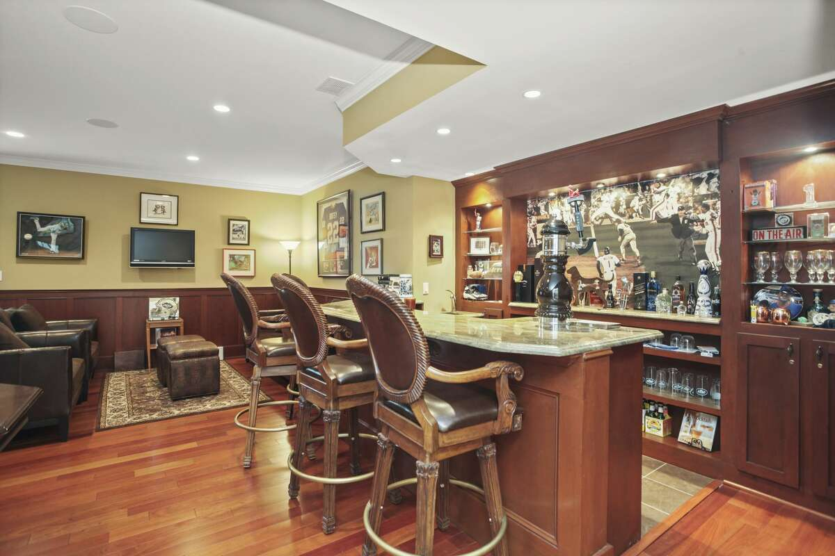 """The 2 Old Farm Lane home in Old Greenwich, Conn., owned by longtime producer of """"The Howard Stern Show"""" Gary Dell'Abate,has a game room (also called the """"man cave"""") with a billiard table and full bar."""