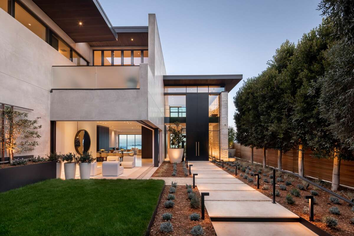 If the dimensions seem impressive, they are: A 19-foot tall motorized entry door fully slides away to a two-story open atrium with a 30-foot-long feature wall.