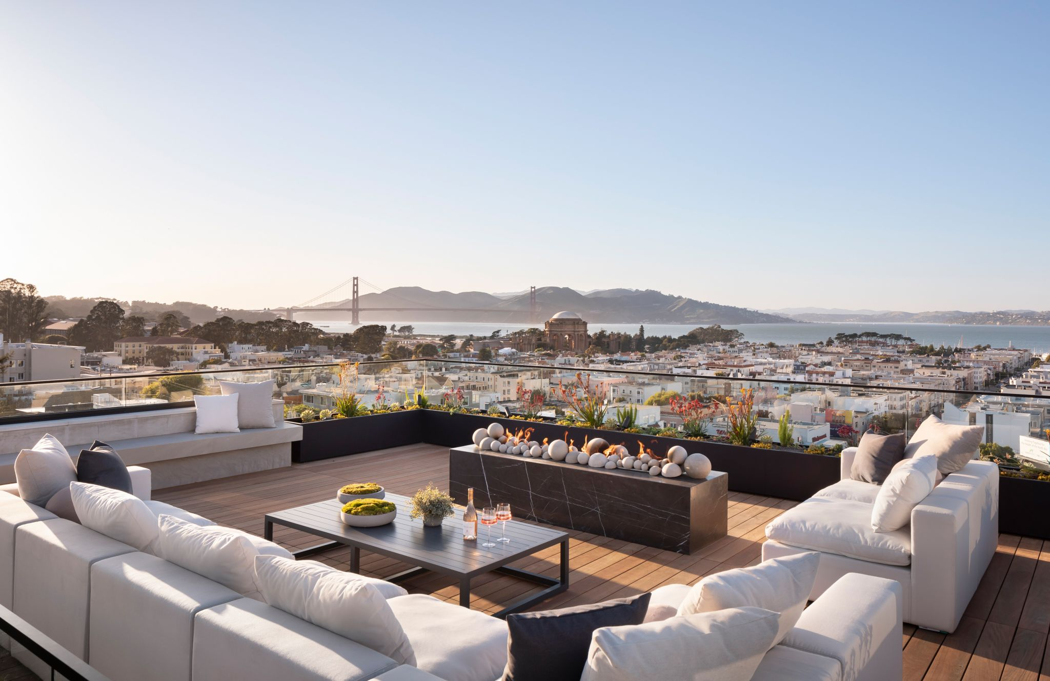 The roof deck offers a stunning view of the city and bay beyond.