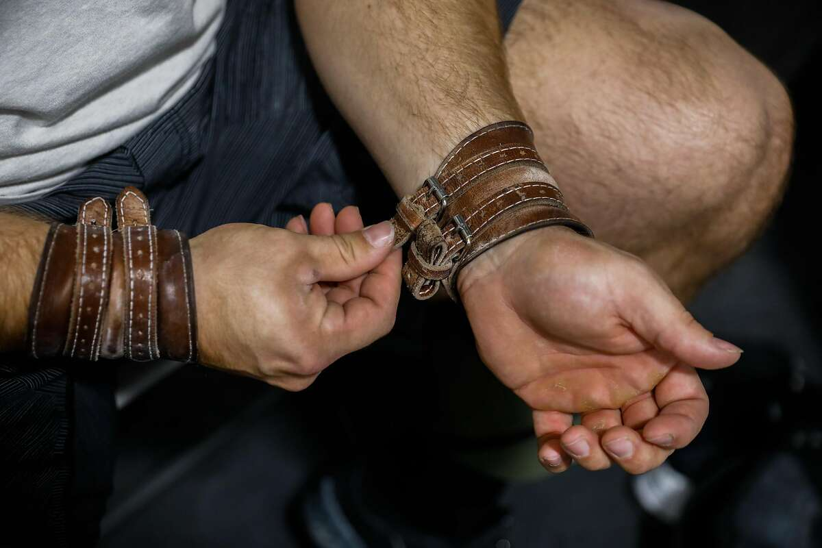 American weightlifter Wes Kitts (center), a Tennessee native who moved to California puts his wrist supports on before a workout at California Strength on Thursday, June 10, 2021 in San Ramon, California. He has qualified for the Tokyo Olympics.