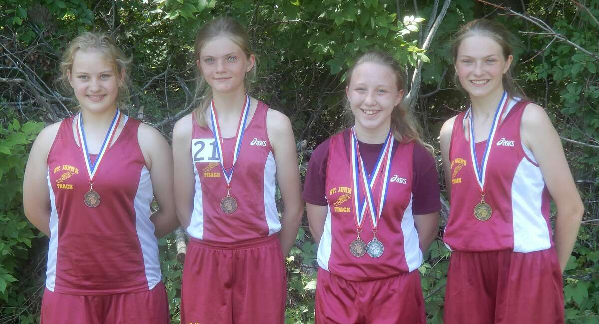 Members of the St. John's Lutheran School track team who placed recently at the Lutheran Schools State Championship meet were (from left) Lena Smazenka, Kelly Derusha, Gloria Stark, and Mckenzie Derusha.