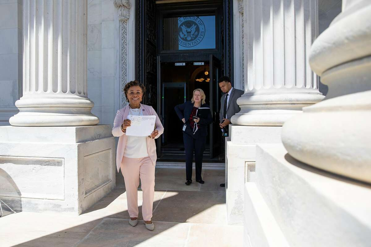 Rep. Barbara Lee leaves the House chamber holding a vote tally for her bill repealing the 2002 Authorization for Use of Military Force was passed by the House of Representatives.