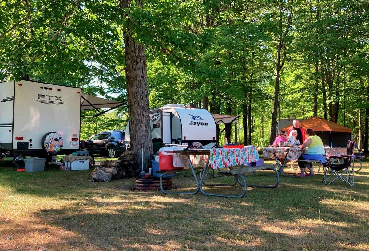 Local campers enjoya mealJune 17 in Wagener County Park during some midweek camping. (Teresa Homsi/Huron Daily Tribune)