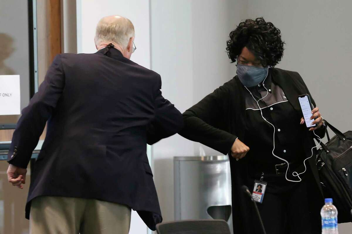 CPS Energy President and CEP Paula Gold-Williams elbow bumps Rate Advisory Committee Chair Reed Williams before the start of their first meeting at the headquarters buildng on McCullough Avenue, Thursday, May 27, 2021. It was also the first in-person meeting held due to COVID-19 restrictions. The 21-member committee was formed in April.