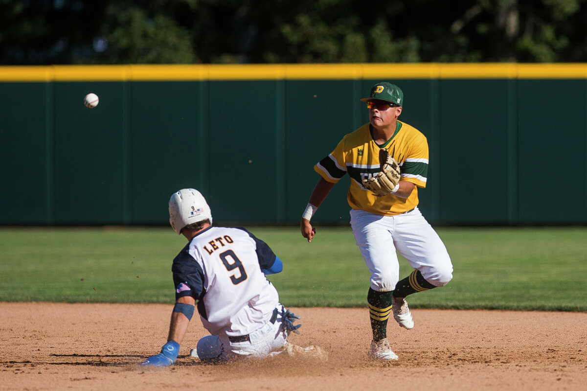 Dow's Logan McCoy reaches out to catch the ball while a runner slides into second base during the Chargers' Div. 1 state semifinal loss to Portage Central Thursday, June 17, 2021 at McLane Stadium in East Lansing. (Katy Kildee/kkildee@mdn.net)