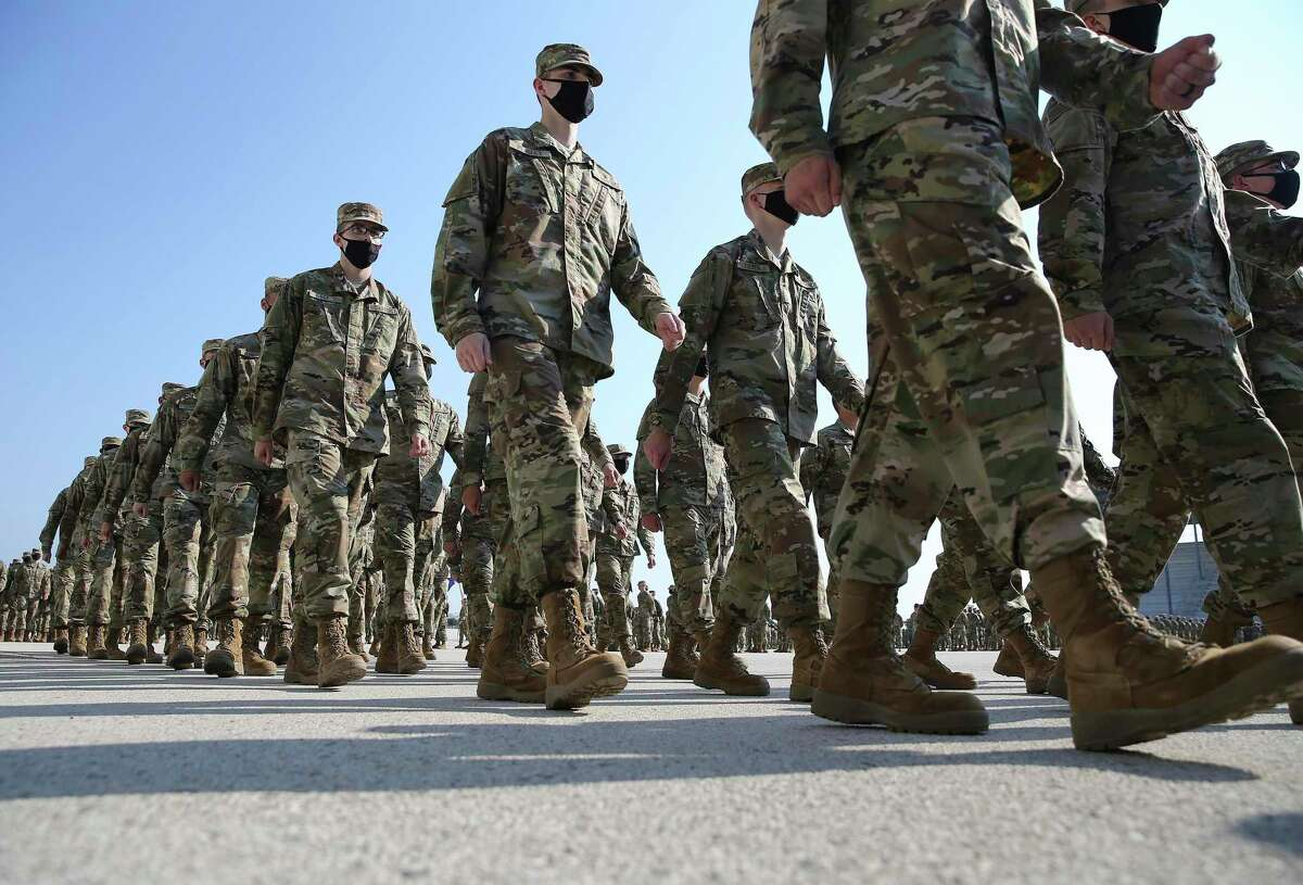 New airmen march in formation as JBSA-Lackland conducts its first pass-and-review ceremony in 15 months on Thursday, graduating after seven and half weeks of basic training.