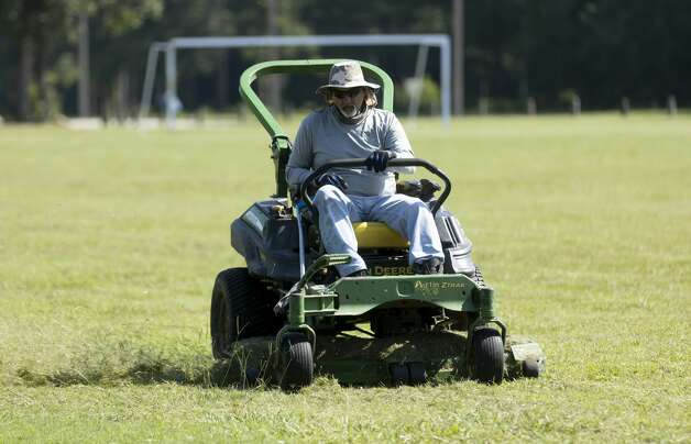 Raymond Mercado with Sports Field Solutions upkeeps the soccer field at the Conroe Founder's Plaza, Wednesday, June 16 ,2021, in downtown Conroe. Photo: Gustavo Huerta/Staff Photographer / Houston Chronicle © 2021