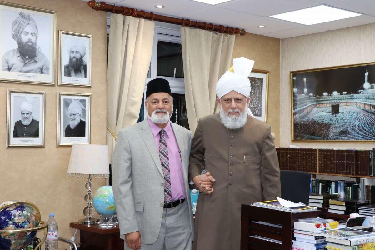 The author's father, Manzur Mannan, the founding president of the Ahmadiyya Muslim Community, along with the 5th Caliph of the Ahmadiyya Muslim Community, Hazrat Mirza Masroor Ahmad.