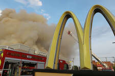 Clouds of smoke billow from the downtown Alton McDonalds, Thursday, June 17. The roof collapsed and firefighters believe the fire began with an AC unit.