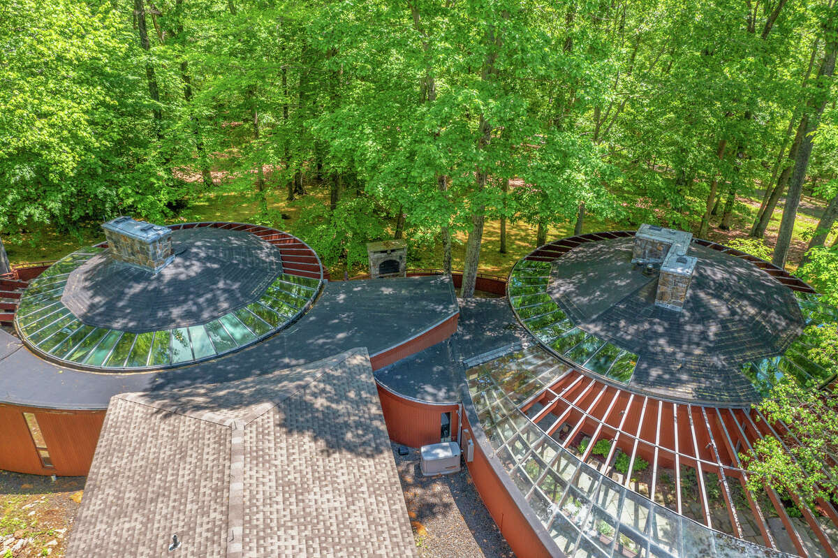 The home on 25 Painter Ridge Road in Washington, Conn. was designed by architect Lester Korzilius, and has three circular pavilions and one rectangular structure added in 2004.
