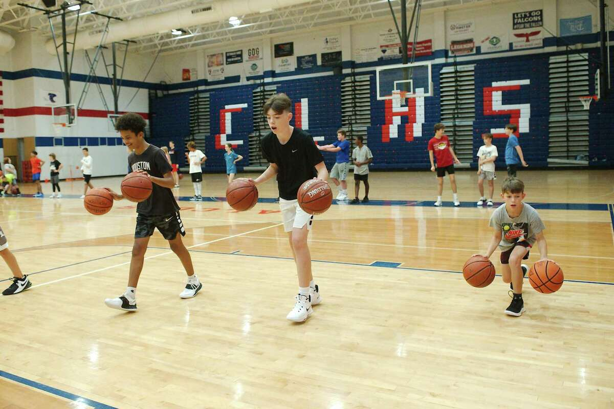 Matthew Lawrent, Logan Perkins and Rowan Book participate in a dribbling drill Thursday at the Clear Lake High School summer basketball camp.