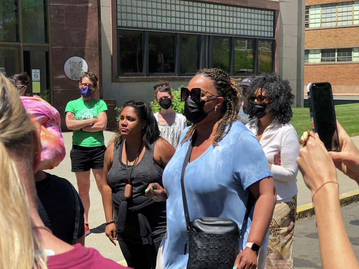 Residents and activists organized by Black Lives Matter New Haven urged Mayor Justin Elicker and the Board of Education to more harshly sanction a former principal who was re-assigned after allegedly using a racial slur during a workshop. Here, Teresa Johnson speaks.