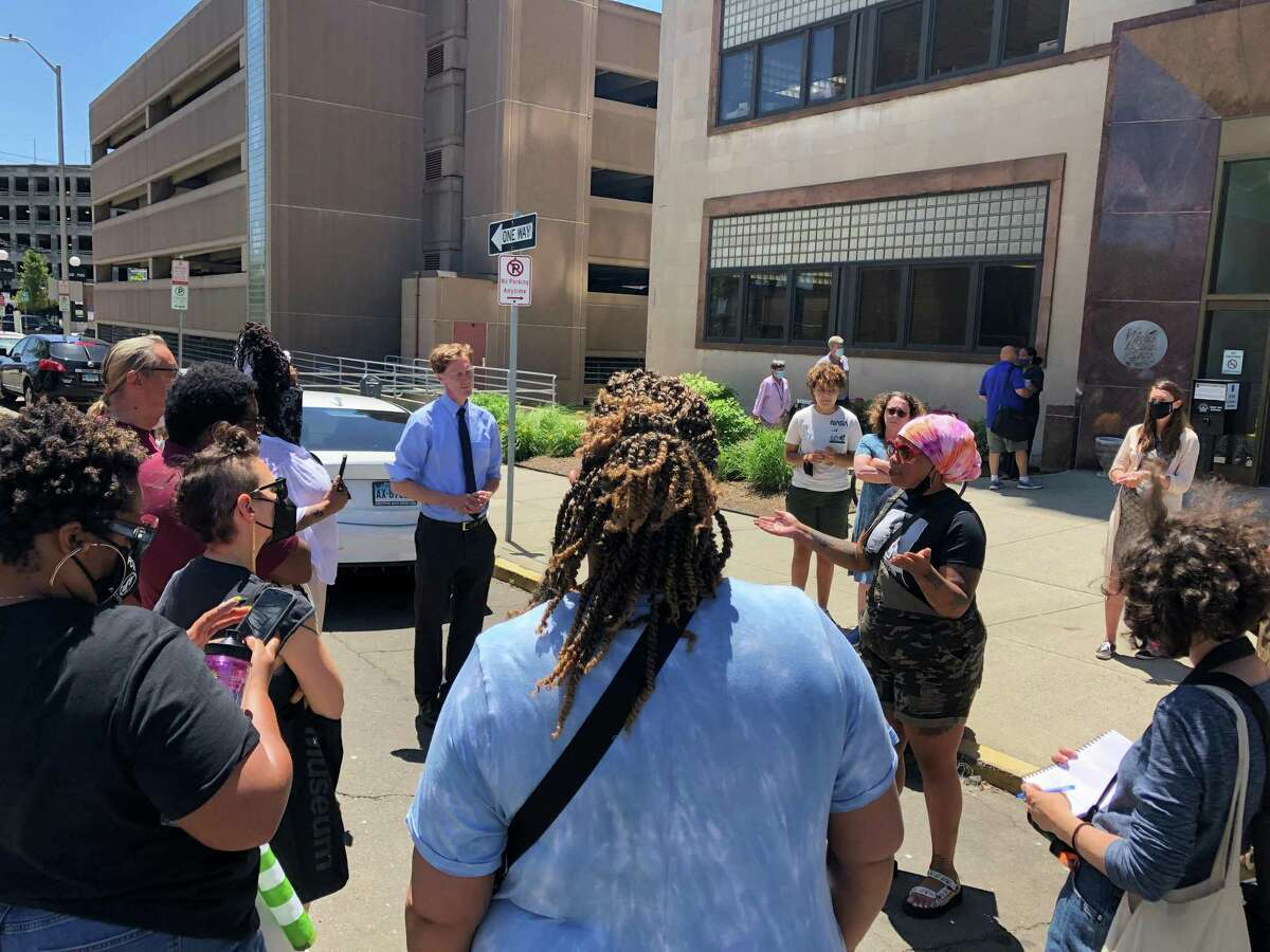Residents and activists organized by Black Lives Matter New Haven urged Mayor Justin Elicker and the Board of Education to more harshly sanction a former principal who was re-assigned after allegedly using a racial slur during a workshop.