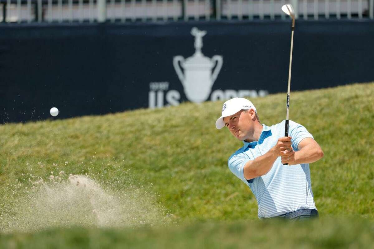 Jordan Spieth of the United States plays a shot from a bunker on the 13th hole during a practice round prior to the start of the 2021 U.S. Open at Torrey Pines Golf Course on June 15, 2021 in San Diego, California.