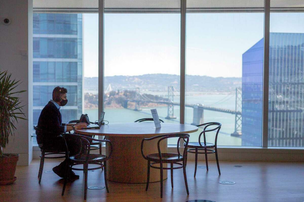 A man works in the Salesforce building with a mask on. Businesses can use their discretion on whether to require masks. State guidelines now allow vaccinated people to go mask-free in most settings.
