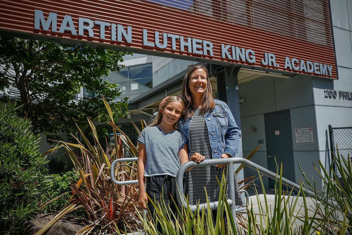 (L-r) Brooklynn Conway, 10 and her mother Jennifer Conway stand outside Bayside Martin Luther King Jr. Academy where she will be going to school in Marin City, California on Friday, June 11, 2021.
