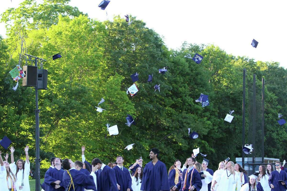 This year, The Morgan School administration allowed the seniors to decorate their caps for the 2021 graduation ceremony. Here they are celebrating after the ceremony.