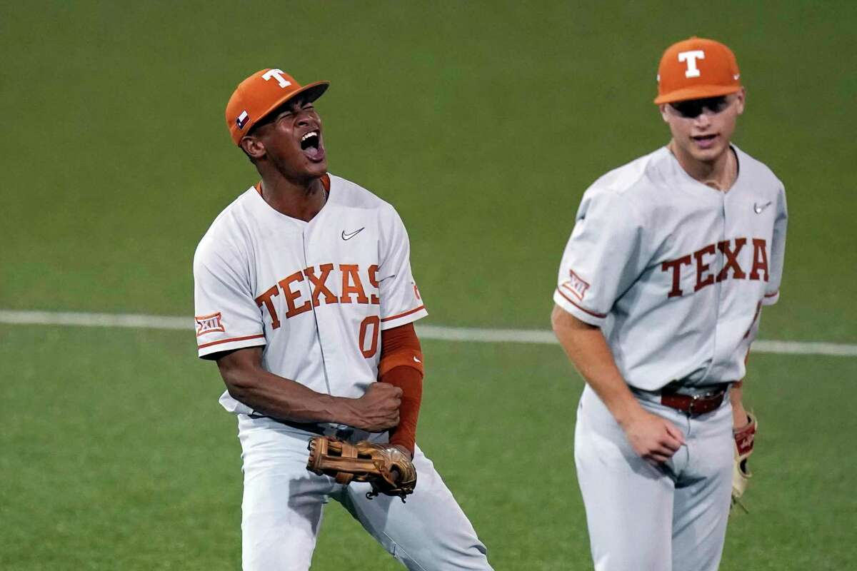 Texas' Trey Faltine (left) and Mitchell Dalycelebrate after turning a double play against South Florida to end the eighth inning in an NCAA Super Regional college baseball game, Sunday, June 13, 2021, in Austin.