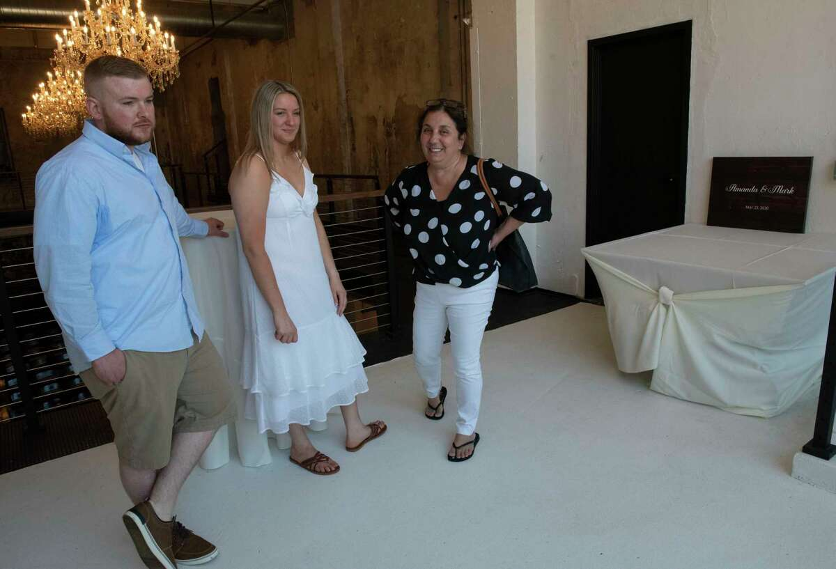 Mark and Amanda Fitzpatrick of Troy go over last minute details with co-owner Belinda Shumway in The Edison on Thursday, June 17, 2021 in Schenectady, N.Y. The banquet facility, which once housed the Schenectady Gazette's printing press, will hold its first ever event Friday, a wedding for the young couple, who had to postpone their nuptials twice before because of the COVID restriction. (Lori Van Buren/Times Union)