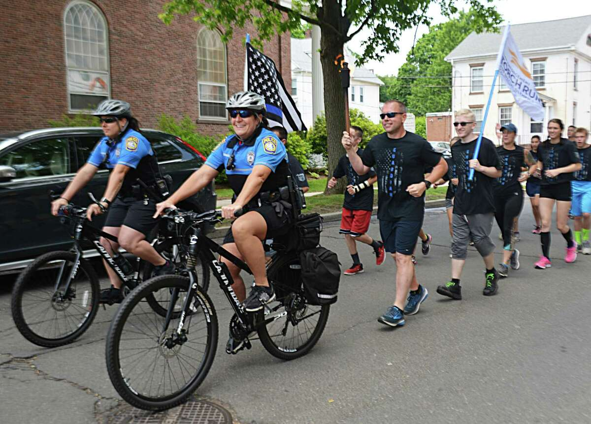 More officers and civilians than ever took part in leg three of the three-day annual Law Enforcement Torch Run for Special Olympics Connecticut in Middletown in 2018.