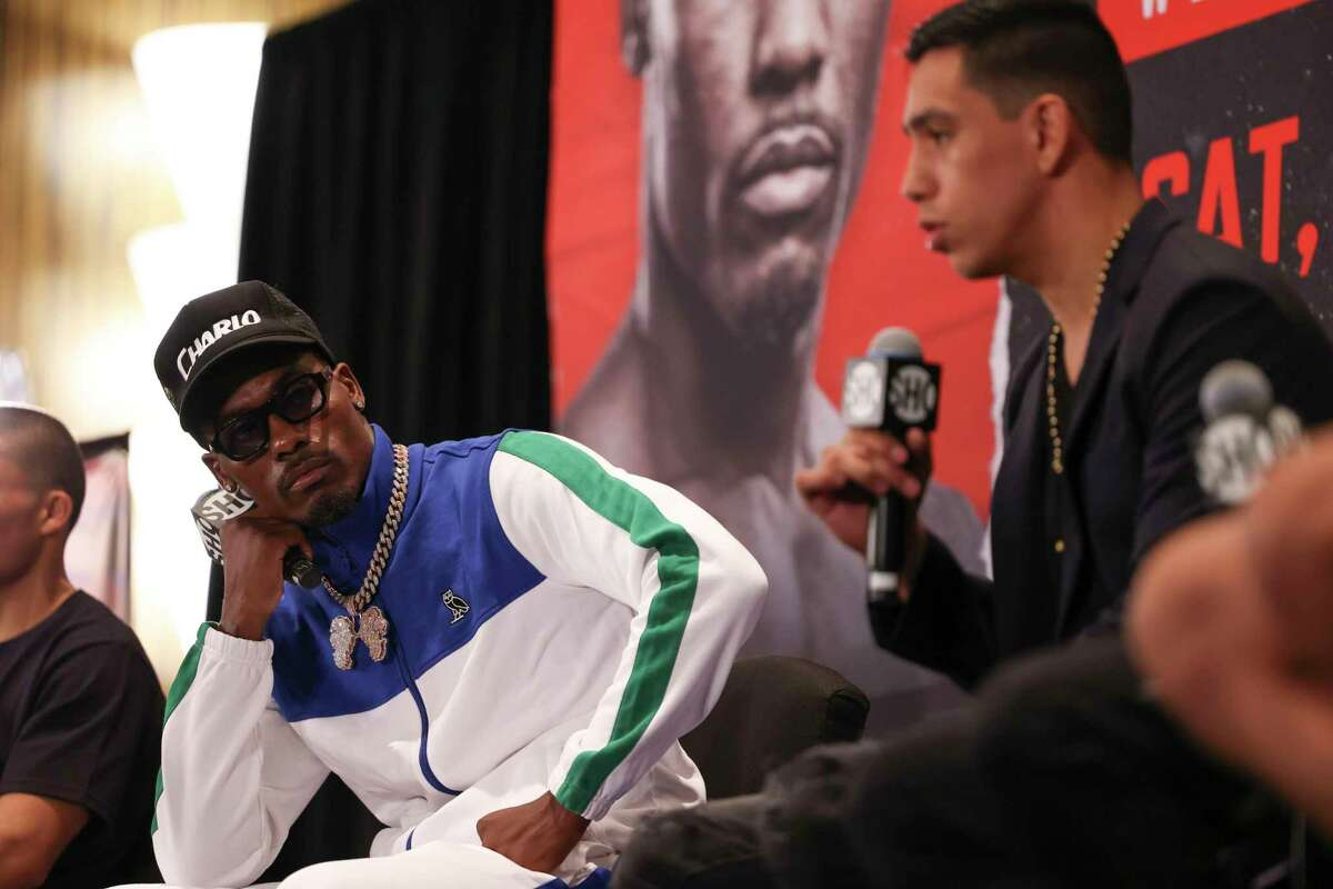 Jermall Charlo watches as Juan Macias Montiel answers questions at the press conferencethe week of their on Thursday, June 17, 2021 at Hilton-Americas in Houston.