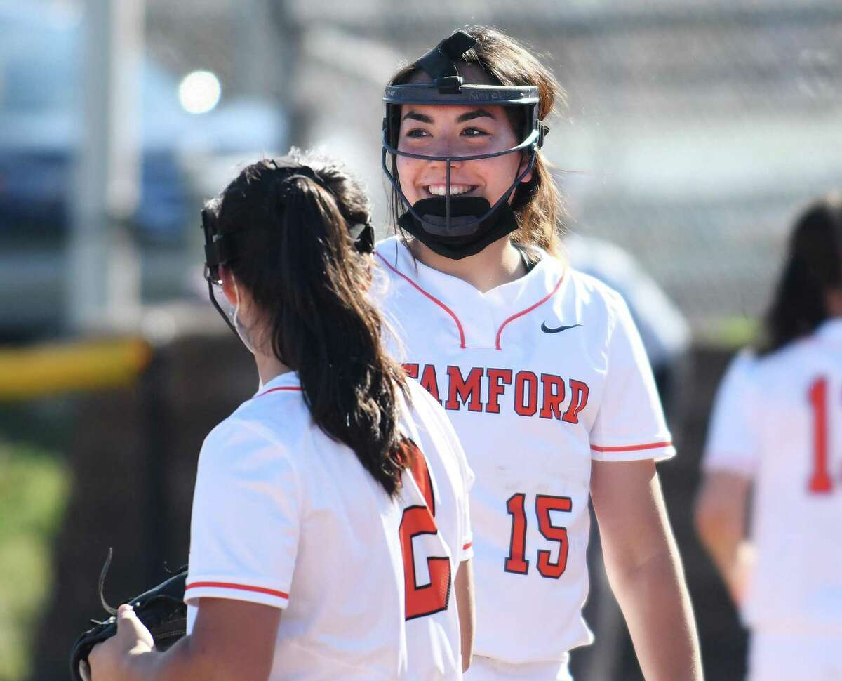Stamford pitcher Kim Saunders smiles between innings against Greenwich in April.