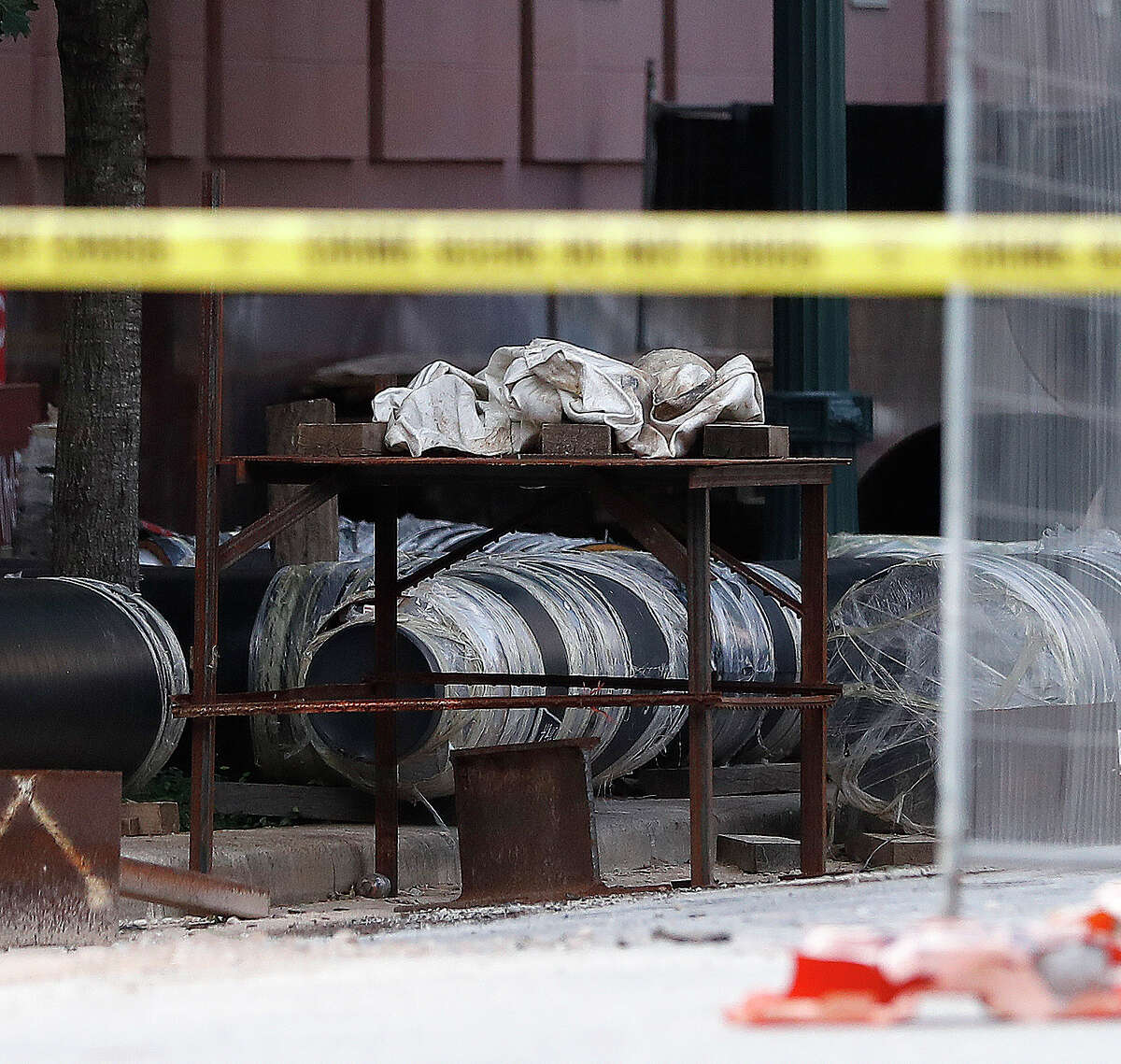Houston Firefighters and investigators on the scene at Preston and Caroline, after construction workers located, what they believe to be a cannonball or other potential explosive device, which was located on the table covered in a white material, Thursday, June 17, 2021.