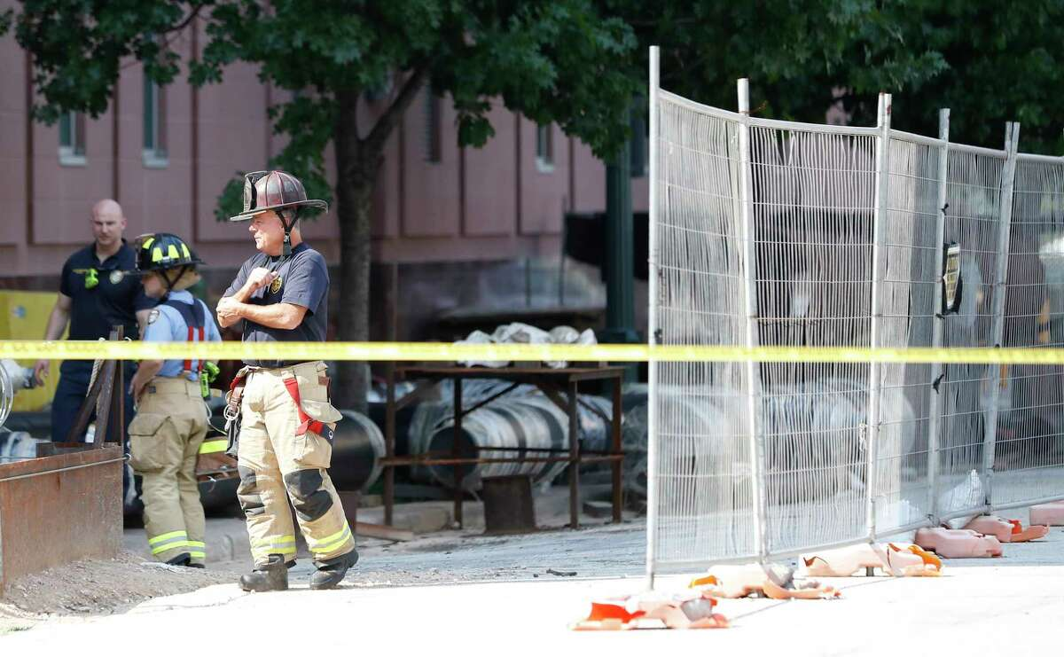 Houston Firefighters and investigators on the scene at Preston and Caroline, after construction workers located, what they believe to be a cannonball or other potential explosive device, Thursday, June 17, 2021.