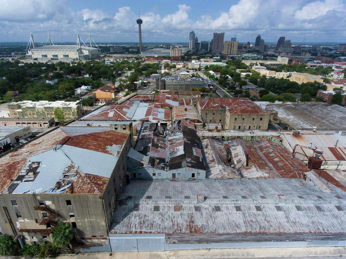 The East Side's abandoned Friedrich industrial complex, seen Wednesday, Oct. 3, 2018 with the San Antonio skyline in the background, is being rebuilt into 350 lofts with the help of the San Antonio Housing Trust Public Facility Corp., a semi-autonomous city nonprofit.