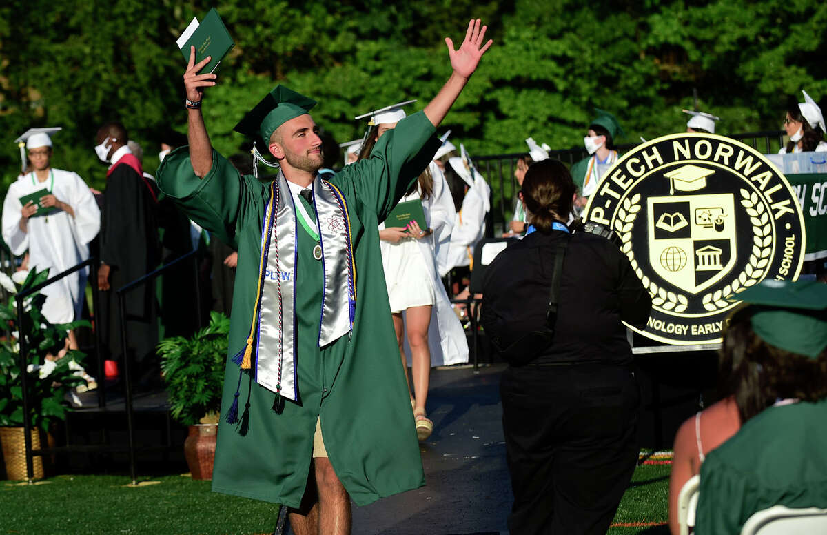 Norwalk High School graduates including Christian Trofa celebrate their commencement Thursday, June 17, 2021, on the football field at the high school in Norwalk, Conn.