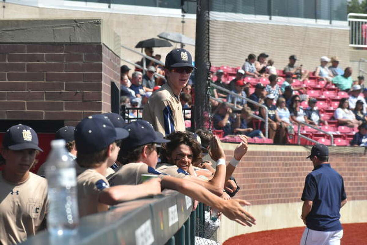 The Father McGivney baseball team gets fired up before the start of the Class 1A state semifinals on Thursday in Normal.