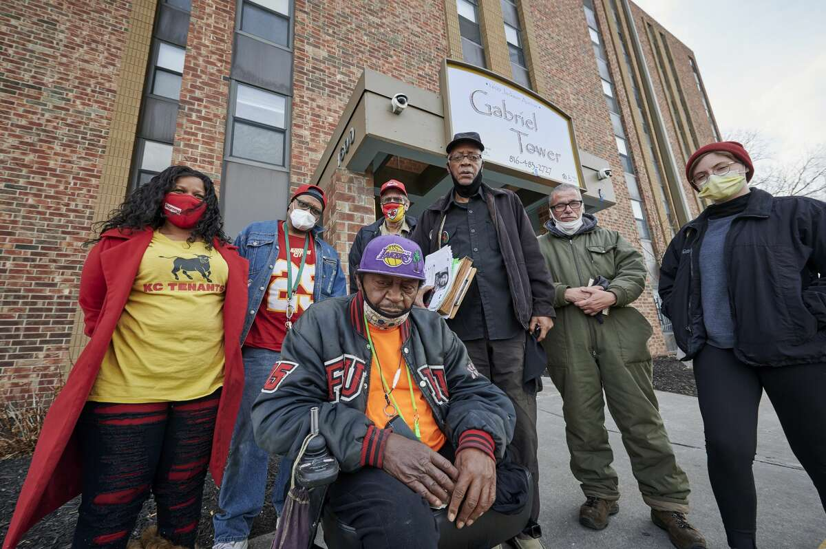 Aggrieved residents of Gabriel Tower Apartments and advocates from KC Tenants are pictured in front of Gabriel Tower Apartments on Jan. 19, 2021. In front is Rick Loker, a resident of the apartments for the past 2.5 years. Back row from left: Tiana Caldwell of KC Tenants; Trent Tyler, a four-year-resident; Jack Sisson, a resident for 7.5 years; Ronald McMillan, a resident for six years; Donnie DeBarge, a resident for 2.5 months; and Wilson Vance of KC Tenants.