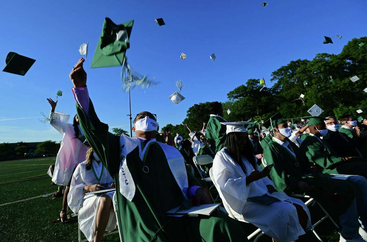 Norwalk High School and P-TECH graduates celebrate their commencement Thursday, June 17, 2021, on the football field at the high school in Norwalk, Conn.
