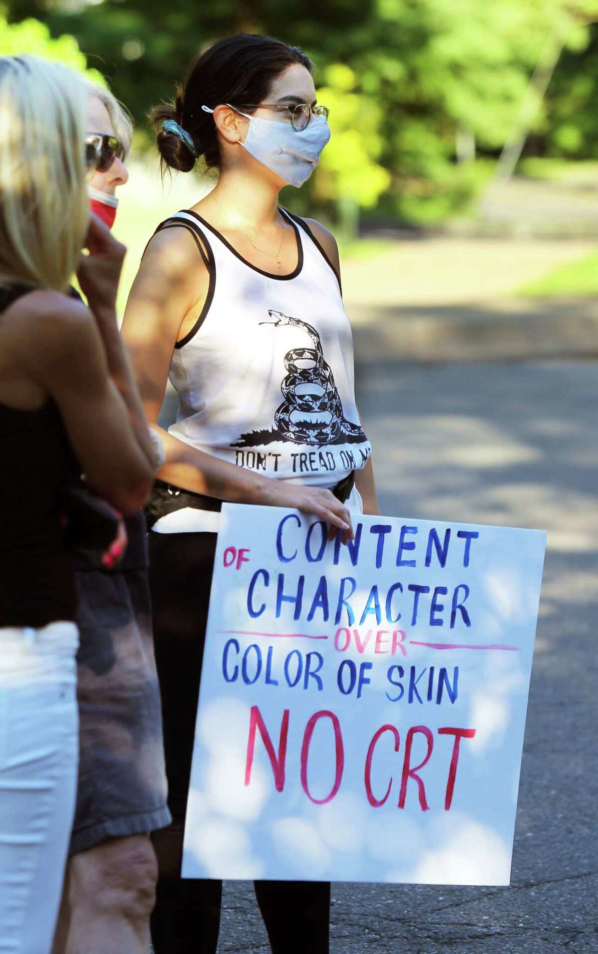 A member of Greenwich Patriots attends a BOE meeting at Central Middle School in Greenwich, Conn., on Thursday June 17, 2021. Members are urging people to attend and speak at public comment to protest masking, vaccinations for students and critical race theory.