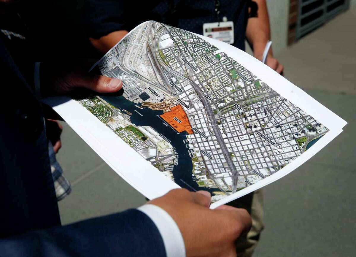 Oakland A's President Dave Kaval displays a map of the Howard Terminal site and surrounding area in Oakland, Calif. on Tuesday, Sept. 3, 2019 where the baseball team is hoping to build its new stadium.