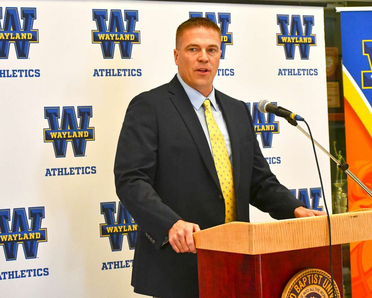 Jason Cooper speaks at his introductory press conference as the new head coach of the Wayland Baptist Flying Queens on Thursday in the Hutcherson Center.