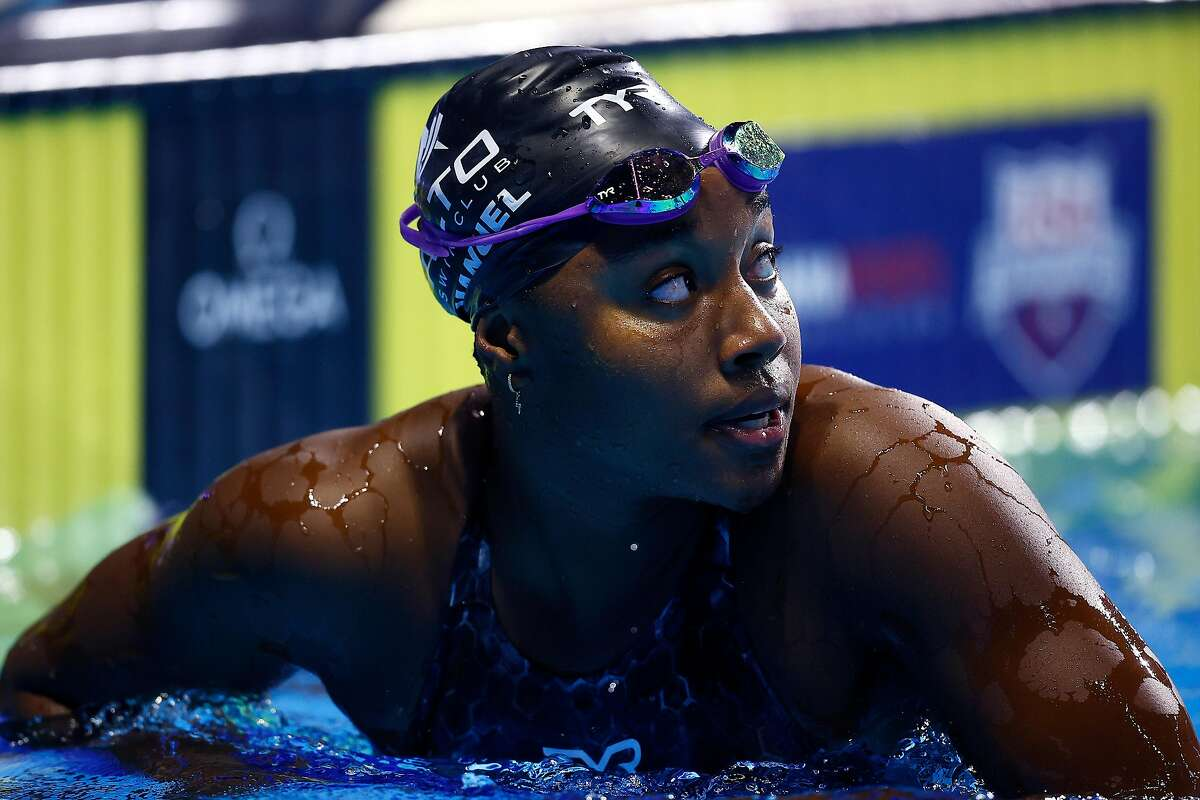Co-defending Olympic champion Simone Manuel reacts after finishing fourth in a 100 free heat, missing a spot in the Tokyo Olympics.