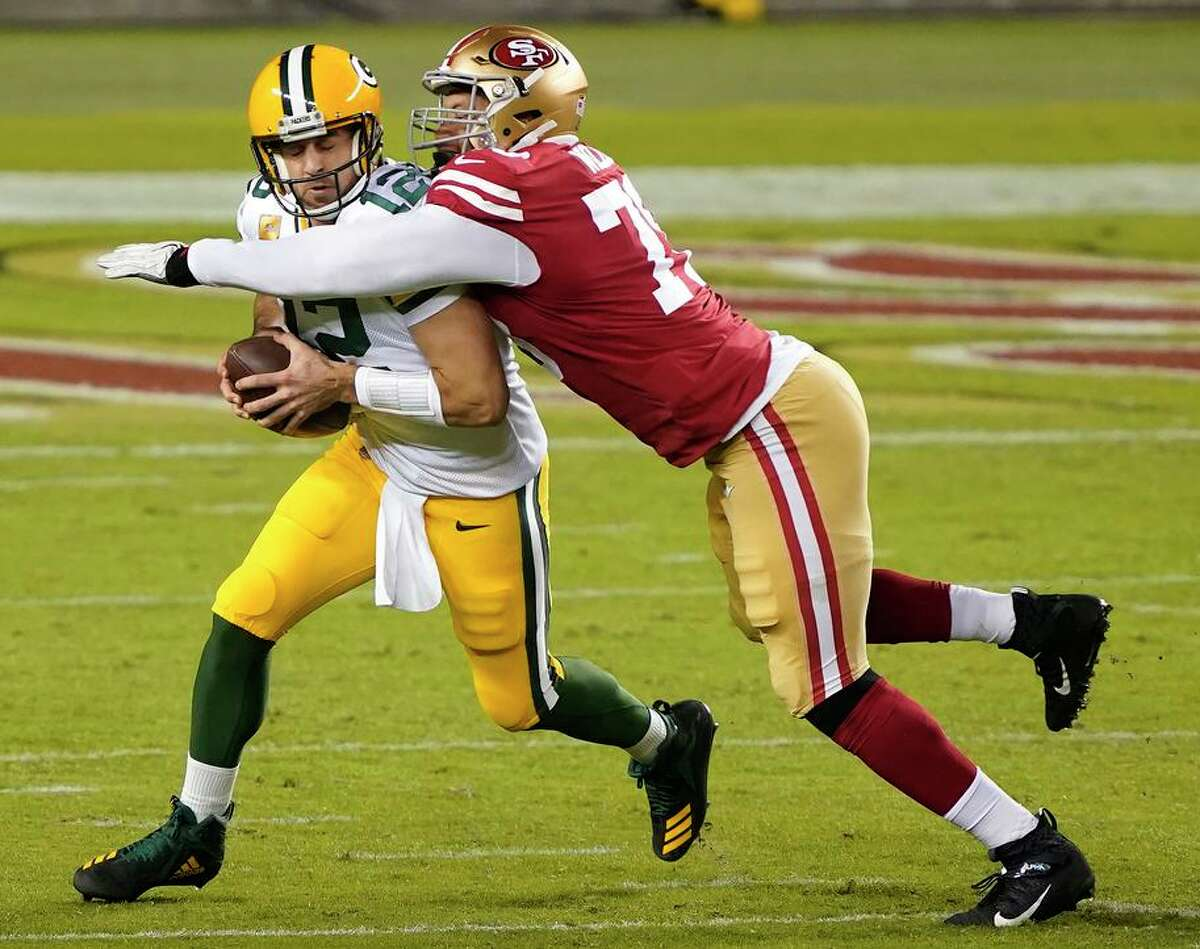 49ers defensive end Jordan Willis, here sacking Aaron Rodgers in 2020, will miss the first 6 games of 2021.