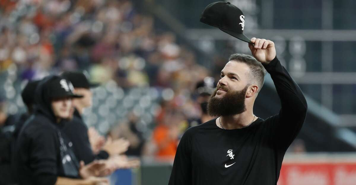 Chicago White Sox pitcher Dallas Keuchel tips his cap to the crowd after he was honored before the start of the first inning of an MLB baseball game at Minute Maid Park, Thursday, June 17, 2021.