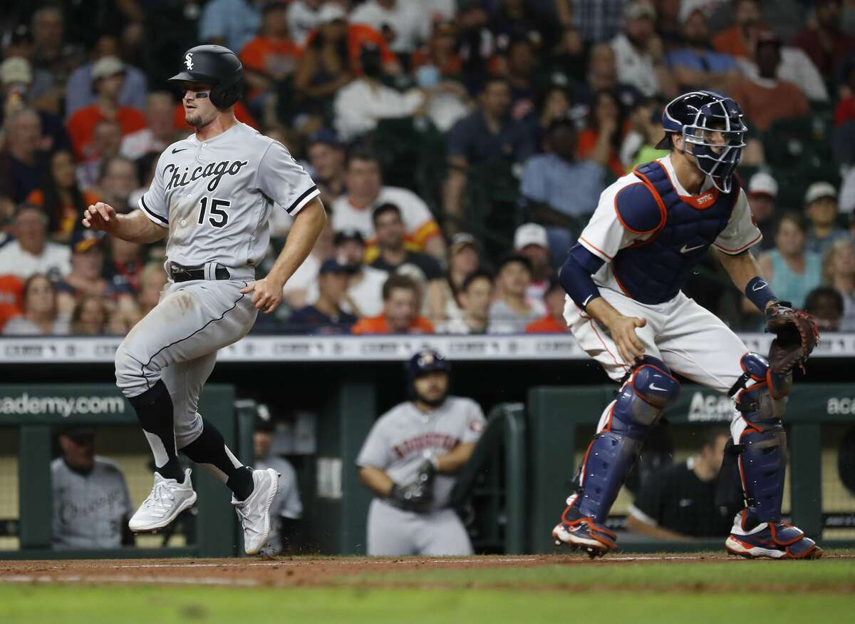 Chicago White Sox Adam Engel (15) scores a run on an RBI single by Jose Abreu during the sixth inning of an MLB baseball game at Minute Maid Park, Thursday, June 17, 2021.